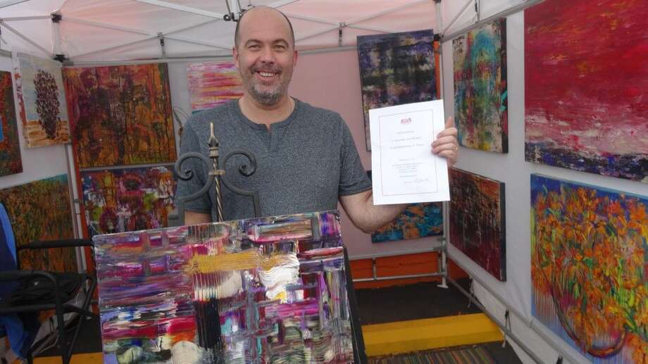 Kingwood artist Eugene John Hughes won best booth display and dinner for two at Alli's Pizzeria at the April First Saturday Arts Market.