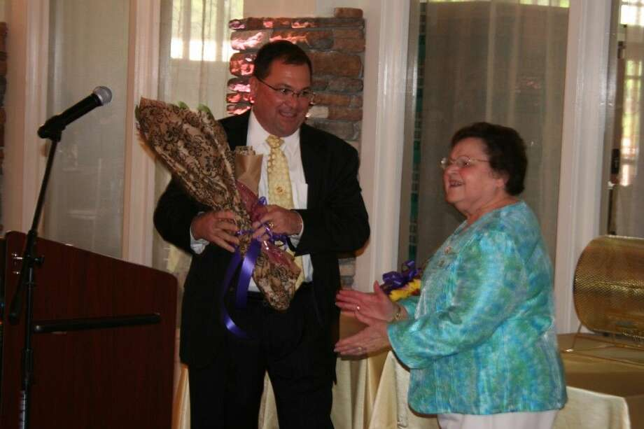 Danny Sullivan surprised his mom with flowers after sharing how she inspired him at the annual FamilyTime Crisis and Counseling Center's Mothers Are Jewels luncheon April 24, 2015.