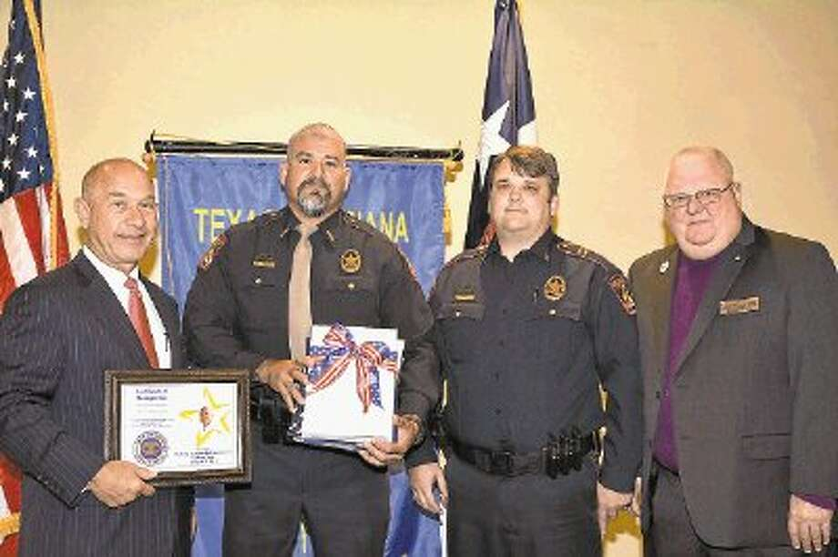 Officer Eddie Canales of the Memorial Villages Police Department was honored recently at the Texas-Louisiana Gulf Coast . Pictured are (from left) Texas Sen. John Whitmire, keynote speaker; Canales, presenting officer Capt. Eric Jones, and District President Steve Wells. Ten law enforcement agencies and 11 officers were honored at the luncheon. Photo: Submitted / @WireImgId=2672350