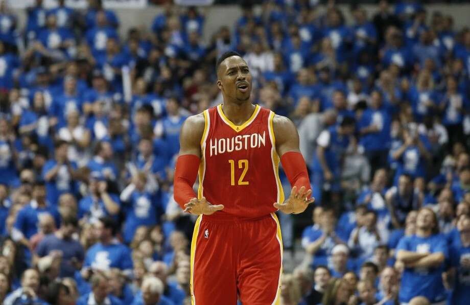 Houston Rockets' Dwight Howard gestures during the first half Friday in Dallas.