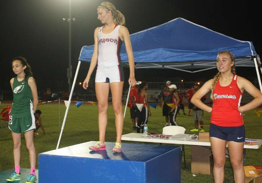Pasadena High School's D'Israel Cardona (far left) joins the other 1600-meter medal winners on the stand at Thursday night's Area championship meet that pitted 22-6A versus 21-6A. For the 1600, it was a 22-6A sweep. Photo: Robert Avery
