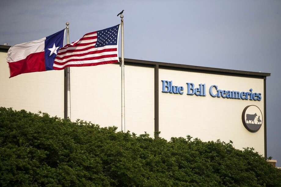 Flags flutter in the breeze outside of the Blue Bell Creameries on Thursday in Brenham,