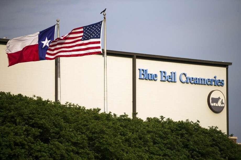 Flags flutter in the breeze outside of the Blue Bell Creameries on Thursday in Brenham,