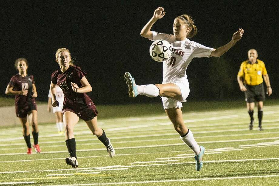 Porter's Kenady Carlile (10) controls a high bounce during Porter's 2-1 playoff loss to George Ranch on April 2, 2015, at Texan Drive Stadium in New Caney. Photo: ANDREW BUCKLEY