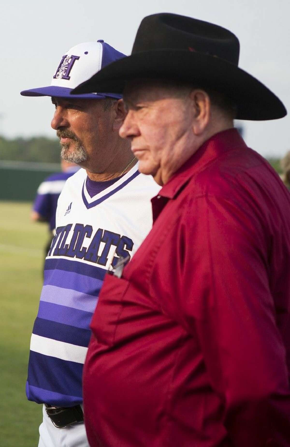 Wildcats head coach David Sitton waits with his father, John, to be honored before Humble's matchup against Barbers Hill on April 24, 2015, at the newly named David Sitton Field at Humble High School.