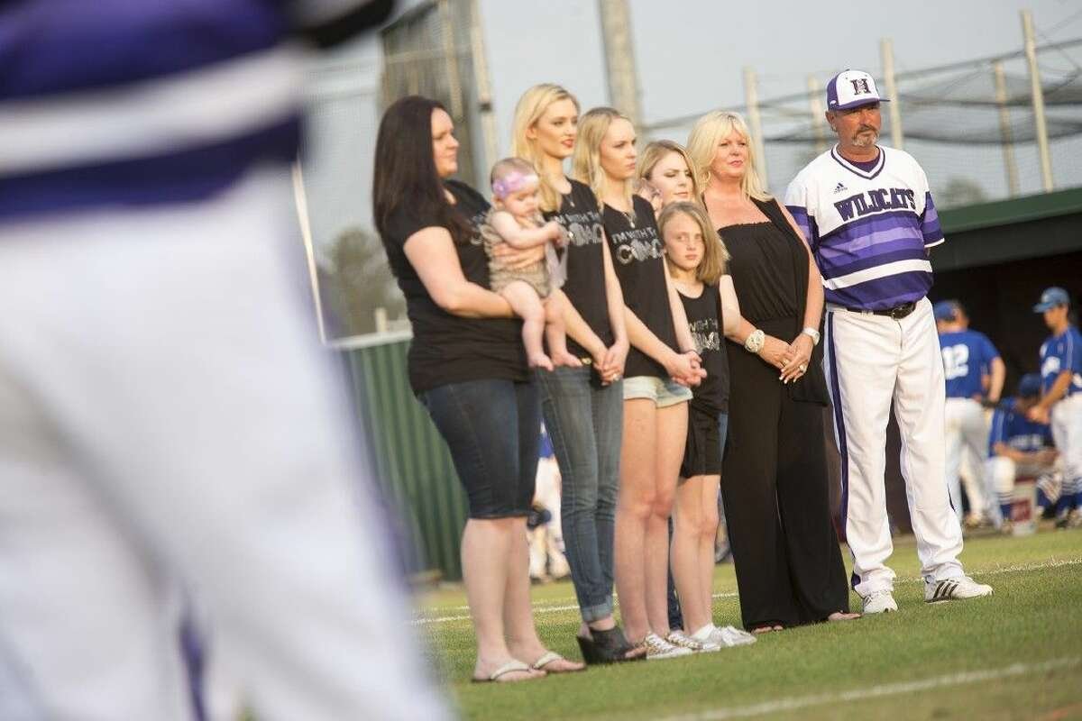 Wildcats head coach David Sitton stands with his family as he is honored before Humble's matchup against Barbers Hill on April 24, 2015, at the newly named David Sitton Field at Humble High School.