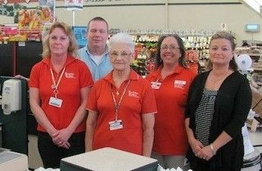 Brookshire Brothers Grocery Store Manager Les Miller and Assistant Manager Shelia Mosley are pictured with the gift card winners in the store's donation drive to benefit Coldspring Area Public Library.