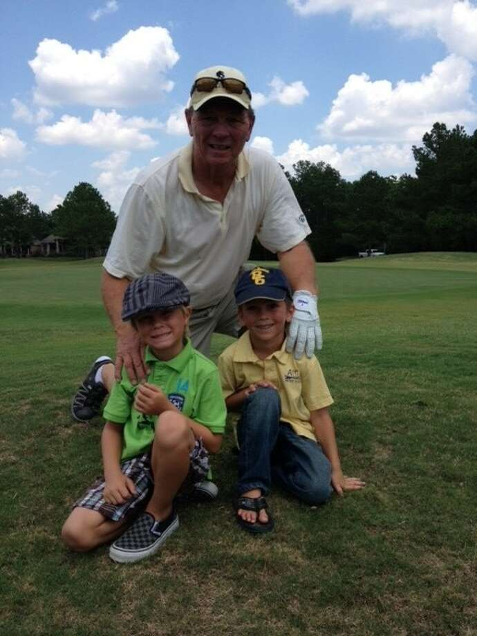 Crosby resident Lenny Moore with his two grandsons cites spending time out on the golf course as one of his favorite pastimes.