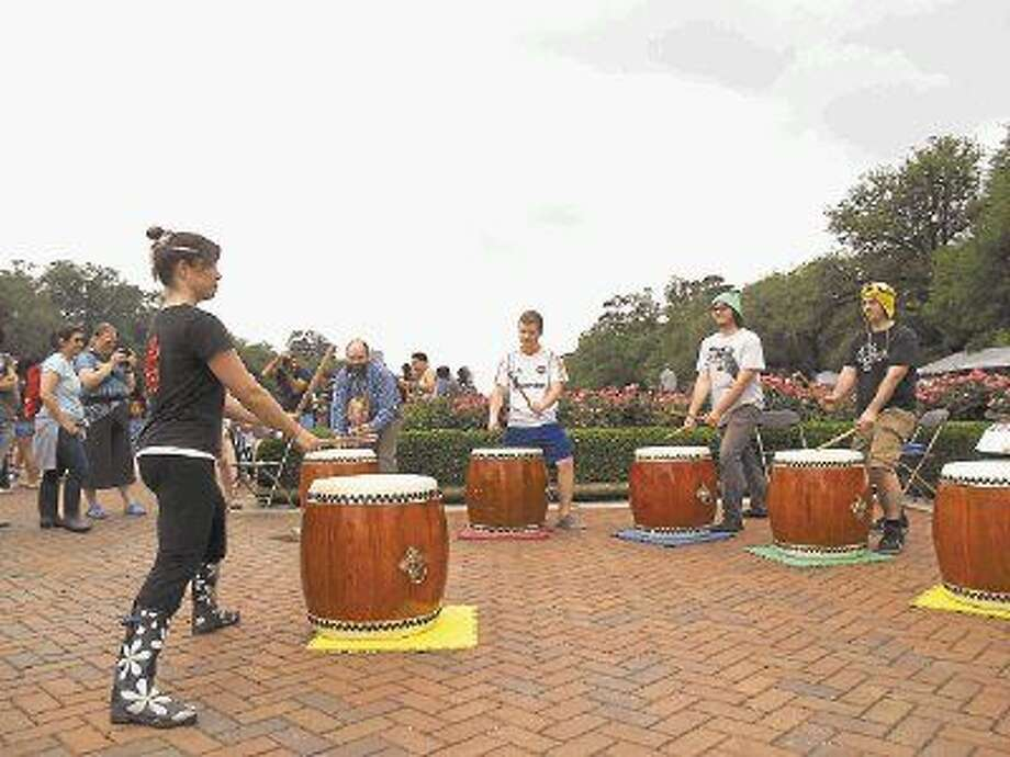 """Natalie Hudson with Kaminari Taiko teaches children to play the """"Taiko"""" at the 22nd Annual Japan Festival on Saturday, April 18th."""