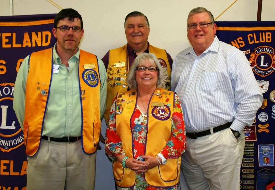 Cleveland Lions Club members, including Thomas Higgins, Mike Penry and Carol Wilmoth, welcome local radio station director Jeff McClain (right) to the April 21 meeting of the Cleveland Lions Club. Photo: Stephanie Buckner