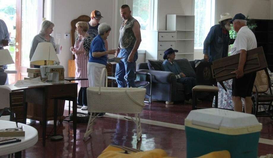 Shoppers browse through the Coldspring United Methodist Church gym, perusing through the various pieces of furniture, large appliances and other items. Photo: Jacob McAdams