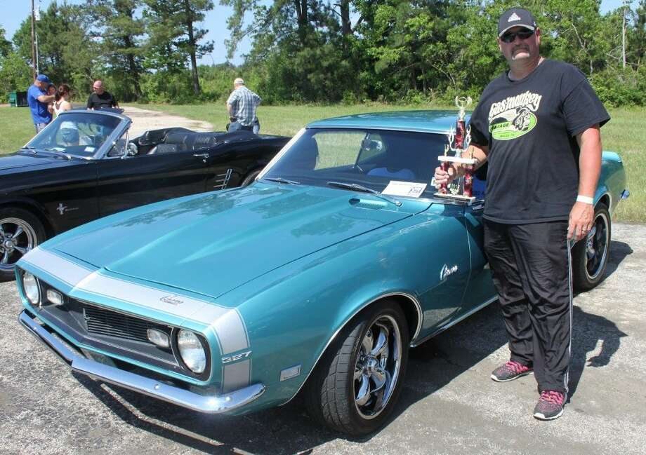 David Tanton stands next to his 1968 Chevrolet Camaro 327, which won Best in Show at the Renegades at the Runway car show on April 25. Photo: Jacob McAdams