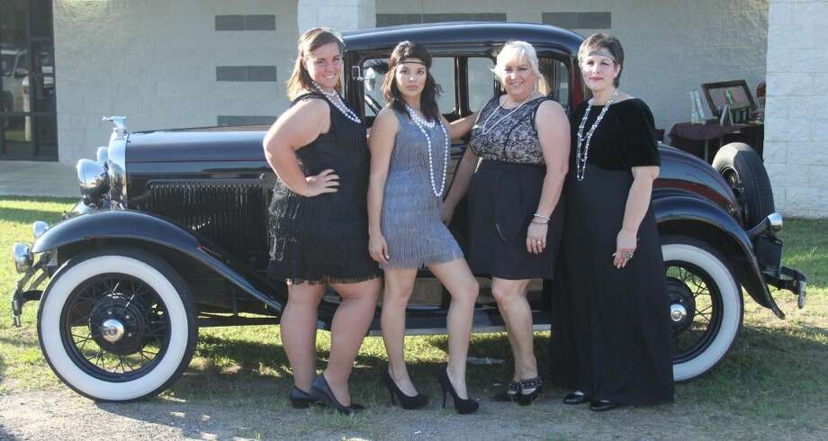 """Four divas gather outside of an antique car, a throwback to the time of the """"Roaring 20s."""" From left to right are Rebekah Rice, Dia Banda, Helen Johnson and Sandy Rice."""
