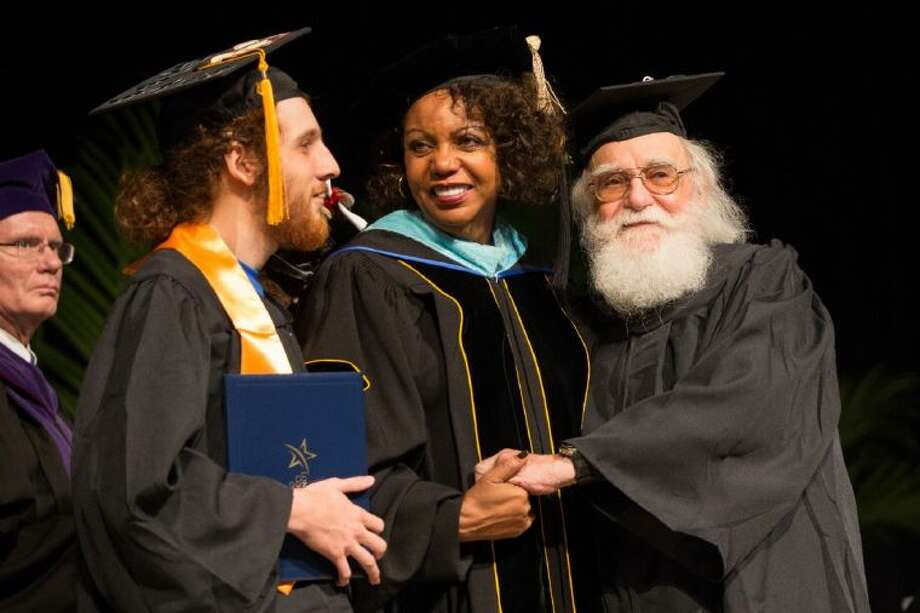 Ken Levin, 83, right, and his 20-year-old son, Herschel Levin, left, receive their Associate of Arts degrees together from Audre Levy, Lone Star College-CyFair President, center, on Saturday, May 10, 2014, at the Berry Center. Photo: Michael Minasi