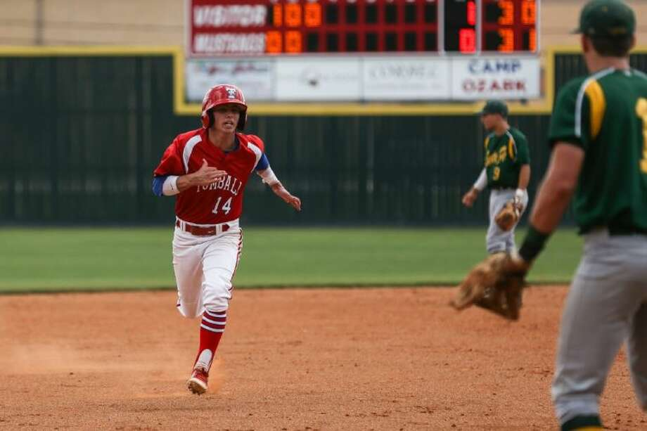 Tomball's Robbie Gillen (14) sprints to third base during the high school baseball game against Santa Fe on Saturday, May 10, 2014, at Spring Branch Memorial High School. Photo: Michael Minasi