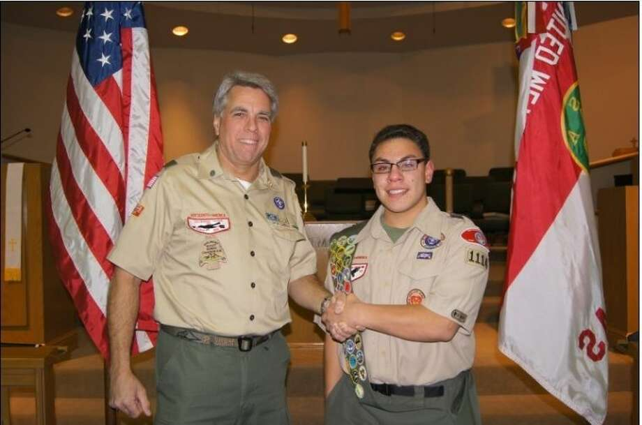 Aaron Adkisson, right, being congratulated by his first Scoutmaster, Zach Hiett, after successfully completing his Eagle Scout Board of Review. Photo: Submitted