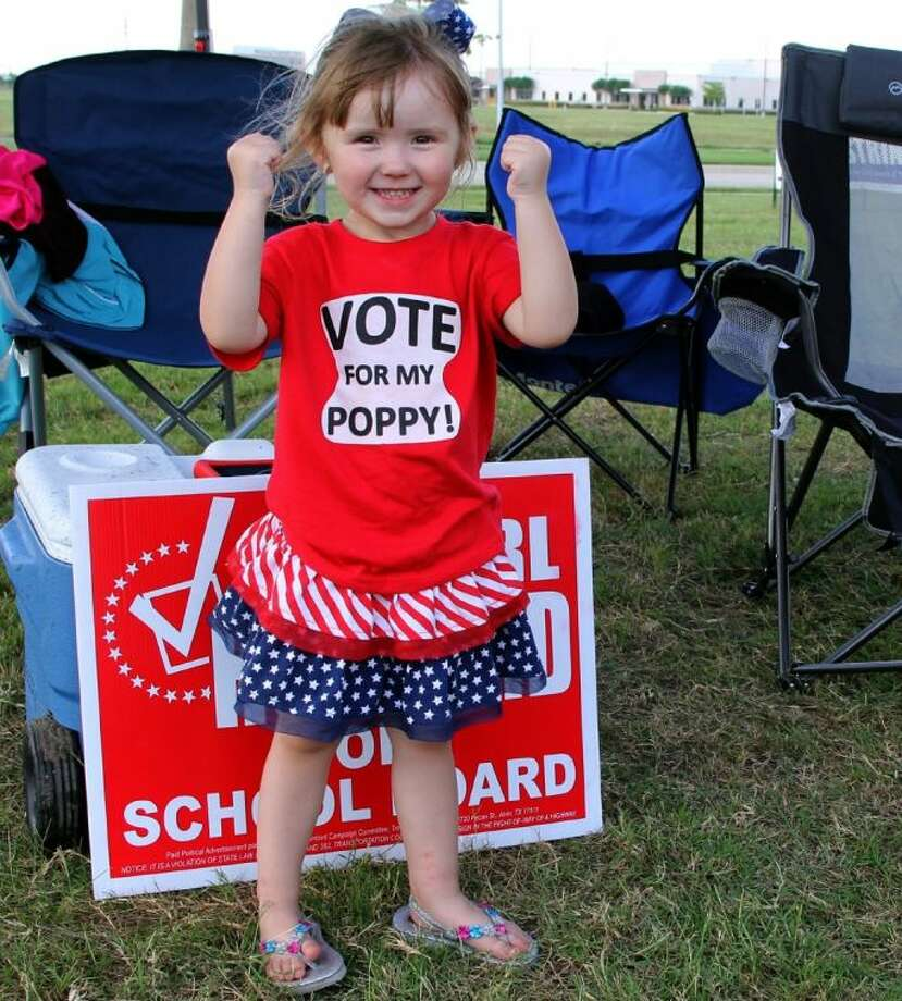 Holly Heil, granddaughter of Alvin ISD Trustee candidate Earl Humbird helped rally supporters on Election Day outside the west Pearland Library polling place. Photo: KRISTI NIX