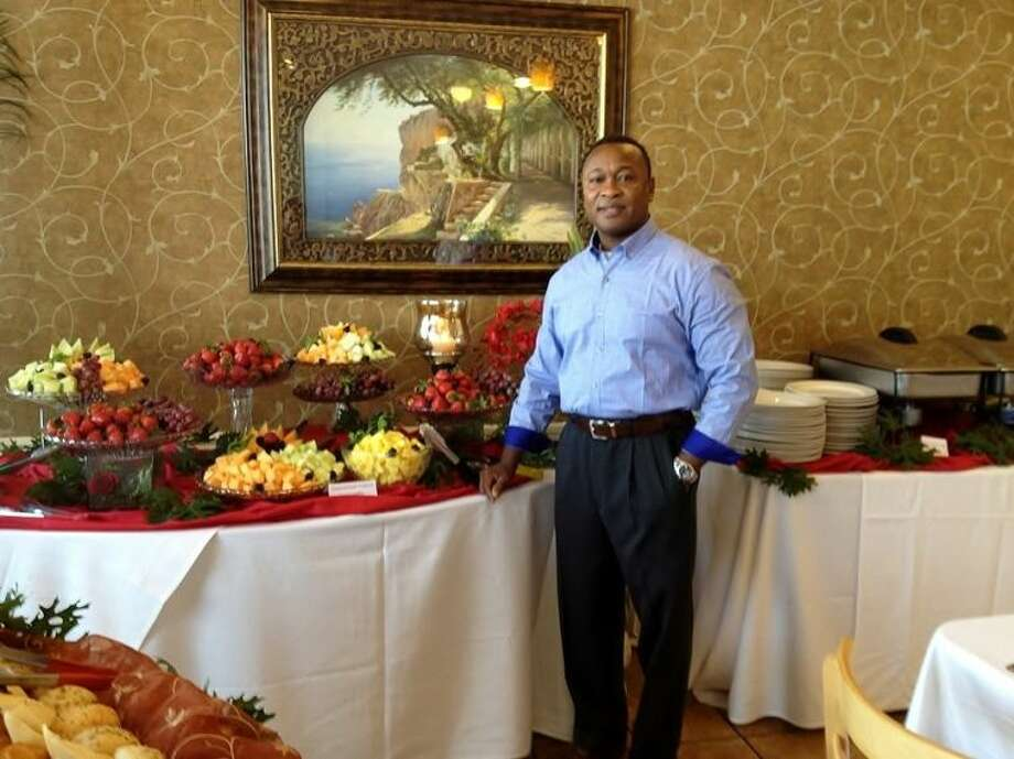 Owner of New Seasons, Edriss Pierre-Louis works to provide ambience as well as excellent food.