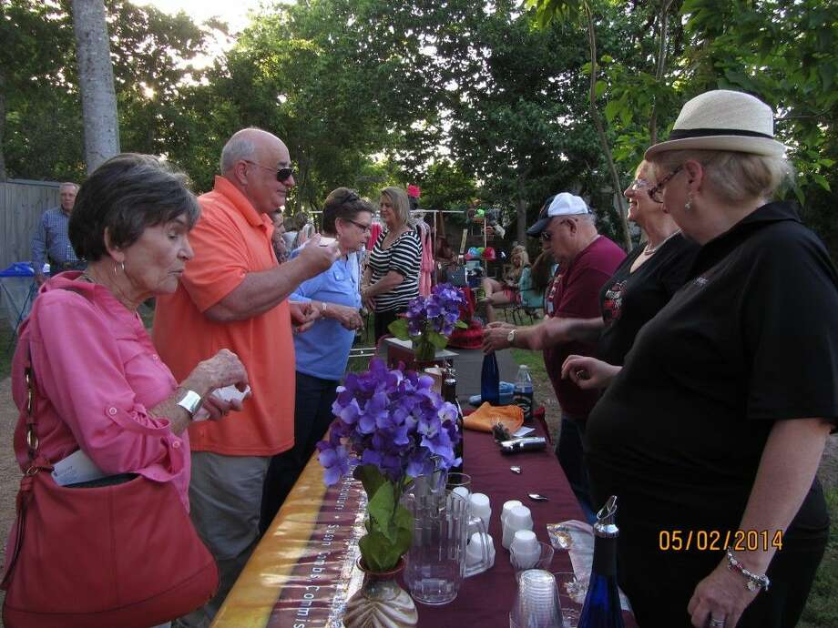 Corks and Canvas last year brought a crowd to The Stroll in downtown Magnolia to enjoy arts, music and wine. This year's event, May 2, will feature Magnolia's Best Bites as well. Photo: Submitted