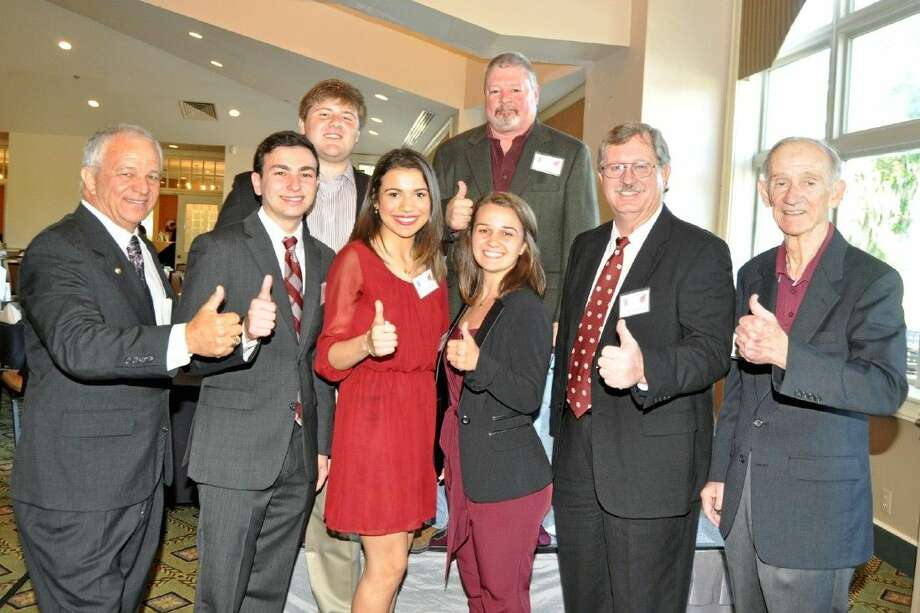 Bay Area A&M Club's scholarship winners are pictured with members of the Scholarship Committee. Pictured from left are Joe Camarata, Leon Coe, Drew Beakey, Kimberly Cross, Camille Camarata, Lou Goates, Mike Cade and Allen Williford.