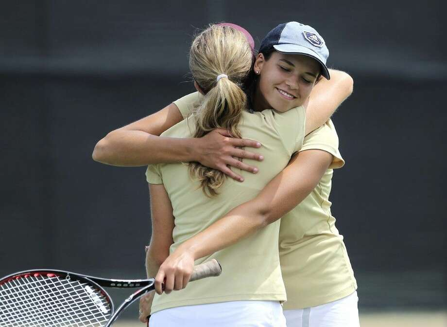 Magnolia West's Ashlynn Broussard and Corrie Yaw celebrate after winning third place in the girls doubles of the Regional III-5A tennis tournament in Willis Wednesday. To view or purchase this photo and others like it, visit HCNpics.com. Photo: Jason Fochtman