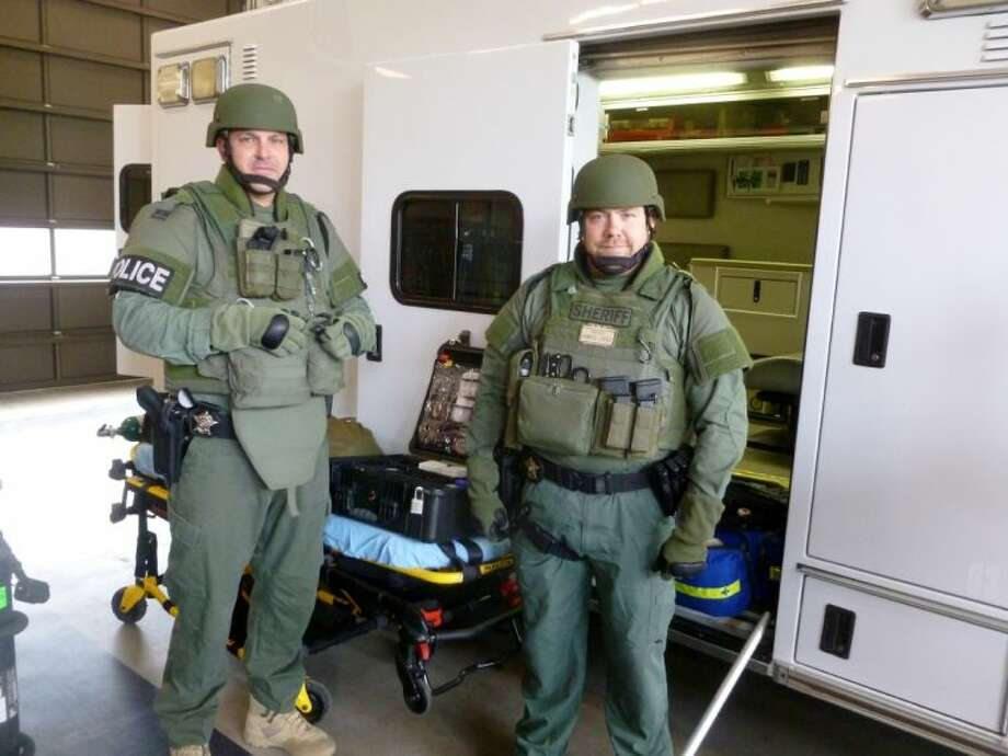 Matt Tomlinson and Eric Barnes are part of the Cypress Creek EMS tactical team.