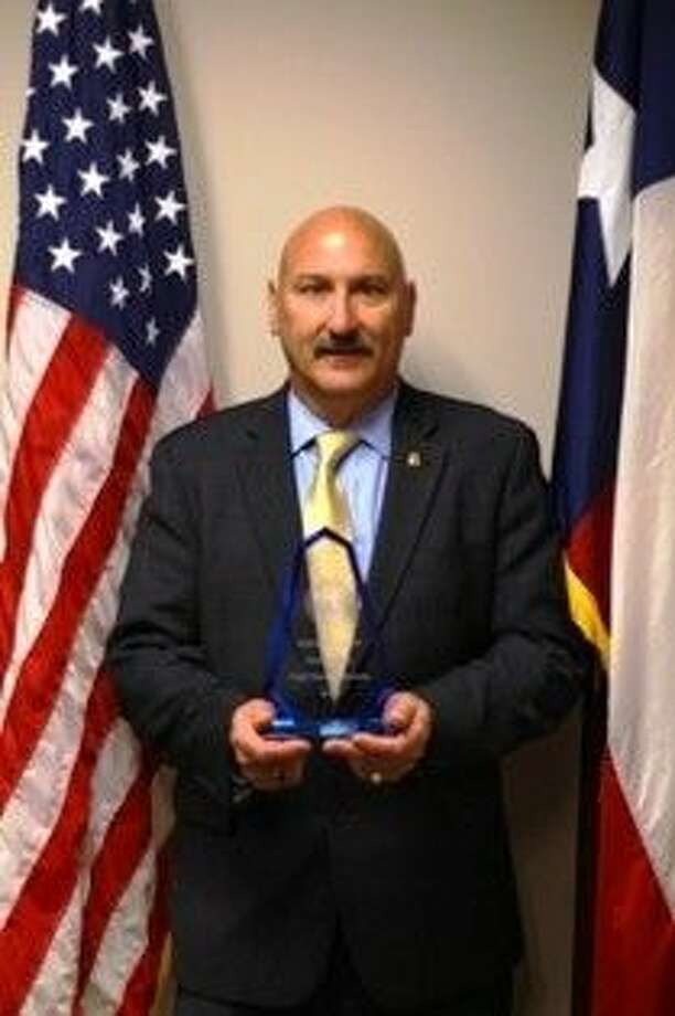 Chief Henry Porretto with NAACP award.