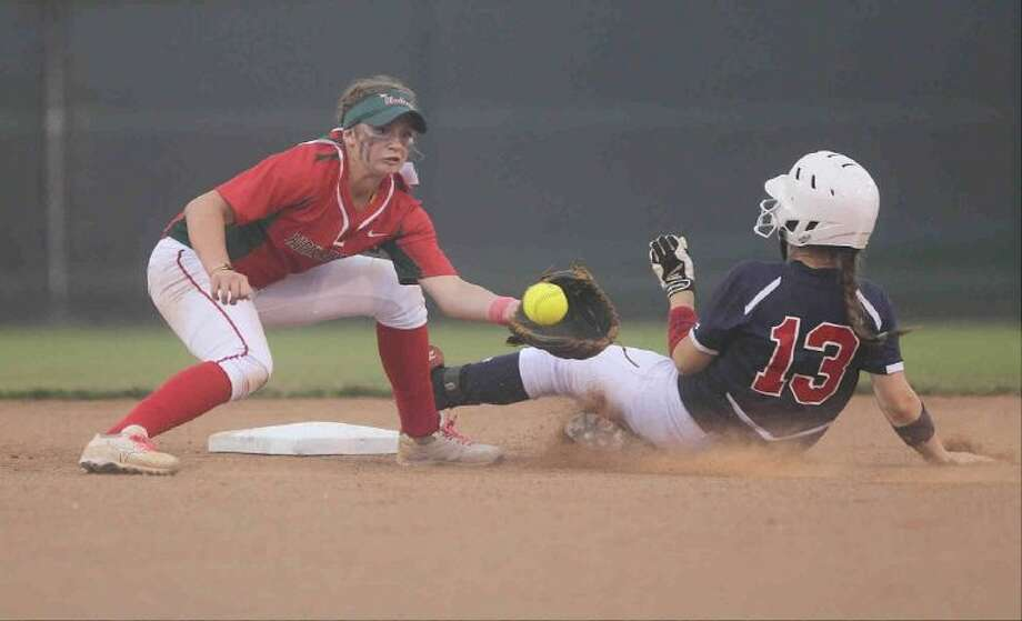 The Woodlands shortstop Aubrey Leach tries to put the tag on Atascocita's Madison Emswiler at second base during Game 1 of a regional quarterfinal series at Porter High School Friday. To view or purchase this photo and others like it, visit HCNpics.com.