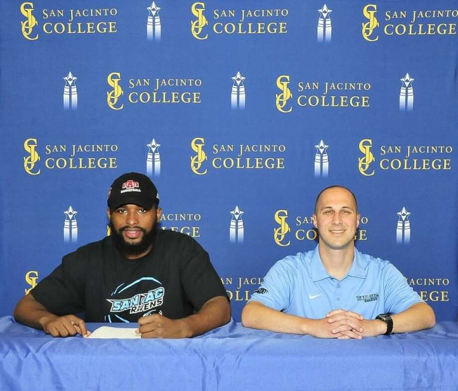Anthony Livingston (left) signed a National Letter of Intent to play basketball next season at Arkansas State University. Pictured with him is San Jacinto College men's basketball head coach Scott Gernander. Photo credit: Jeannie Peng-Armao, San Jacinto College marketing, public relations, and government affairs department.
