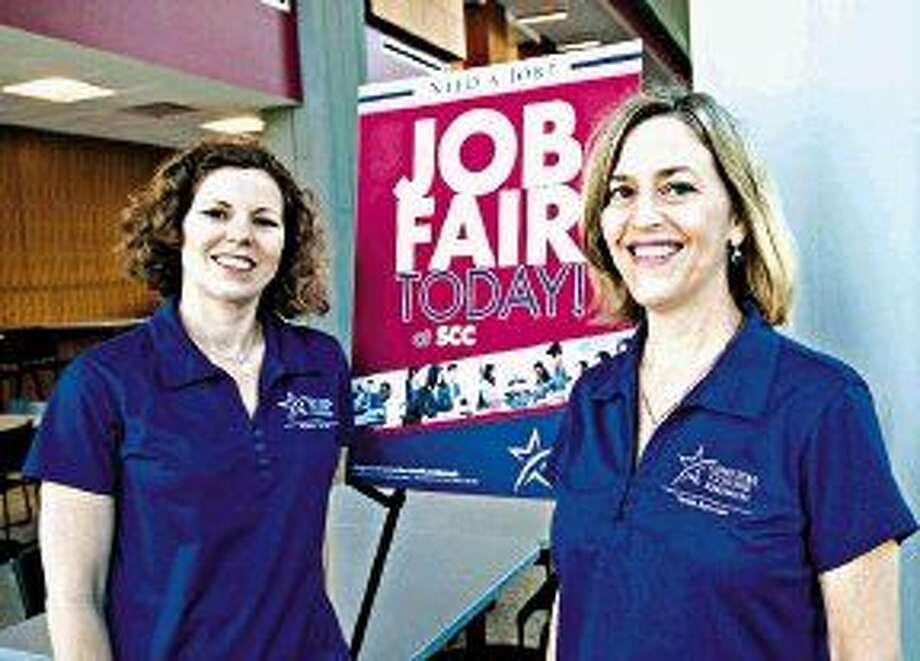 Lone Star College-Kingwood, Kim Hammond, career services employment specialist and Jill Todd, career services program director, prepare for the Job Fair and Summer Internship Showcase on May 13.