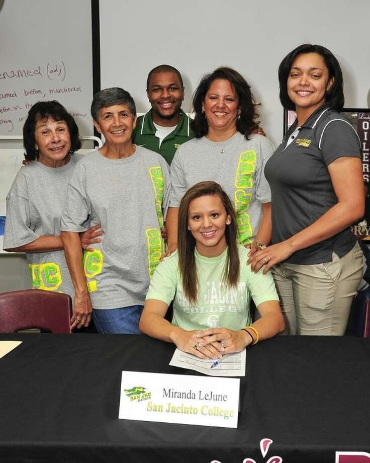 Pearland High School girls basketball player Miranda LeJune, seated, recently signed a National Letter of Intent to play basketball next season at San Jacinto College. People showing their support (standing) include, from left, Jessica Peppers (aunt), Tommie Estrada (grandmother), San Jacinto College volunteer assistant coach Kevin Jackson, Tommie L. LeJune (mother), and Brenita Williams-Jackson, San Jacinto College women's basketball head coach. Photo credit: Rob Vanya, San Jacinto College marketing, public relations, and government affairs department.