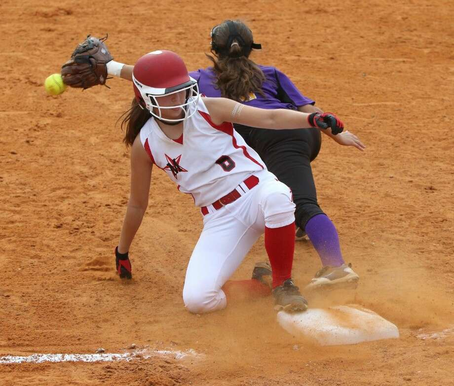 St. John's Brooke Rebecca Reza (6) slides into third safe against Kinkaid's Sarah Lasater during the Southwest Preparatory Conference rivals' game last Thursday night at St. John's. St. John's, along with Kinkaid, will both now get ready to play in the SPC tournament, which begins Wednesday afternoon in Fort Worth. St. John's was the SPC champion two years ago. To view or purchase this photo and others like it, go to HCNPics.com. Photo: Staff Photo By Alan Warren