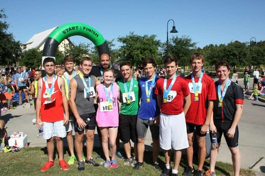 Members of the Travis High School Triathlon Team recently participated in Springs Back Triathalon in Fulshear. Participating students include (from left) Reed Hulsman, Billy Imming, Jay Rivera, Staff Sponsor Mat Yelvington, Taylor Davenport, Jake Polansky, Tyler Deiss, Jake Prep, Travis Cooper, Hunter Barrows. Photo: Submitted Photo