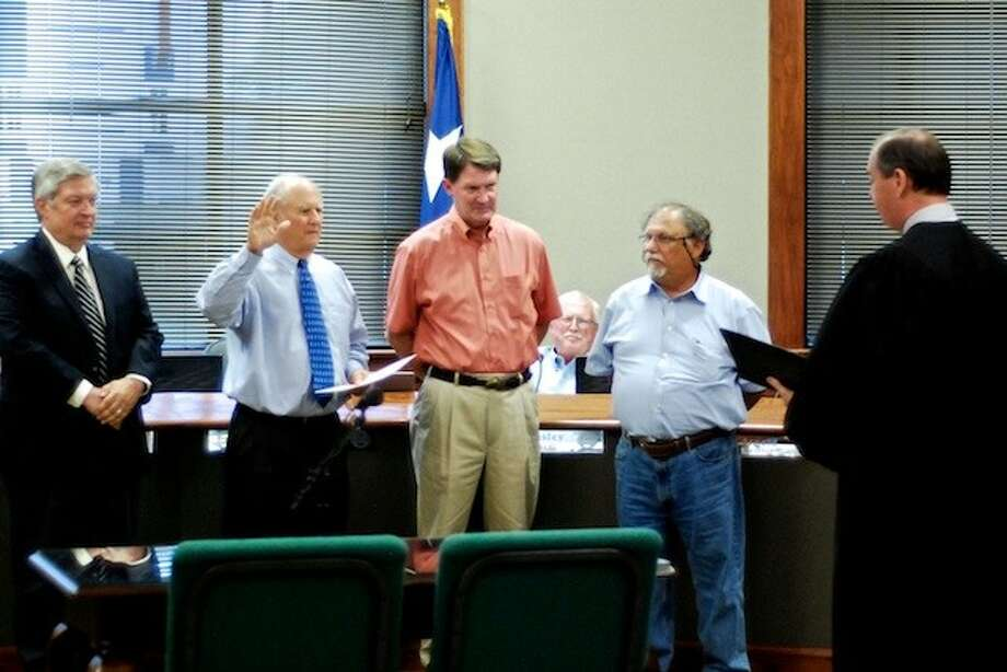 Mayor Carl Pickett takes his oath of office Tuesday, May 13. Municipal Judge Mike Little administered the oath to the mayor and to Councilmen Frank Jordan, David Arnold and Louie Potetz. Photo: CASEY STINNETT / Houston Community Newspapers, 2014