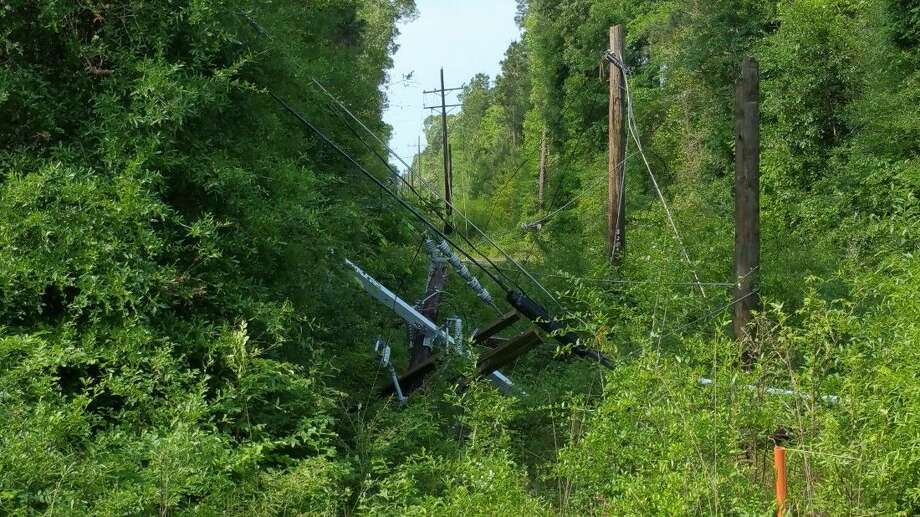 Monday's storms knocked down Entergy Texas, Inc. poles and wires along Woodland Lake Drive in Shepherd. Photo: Submitted