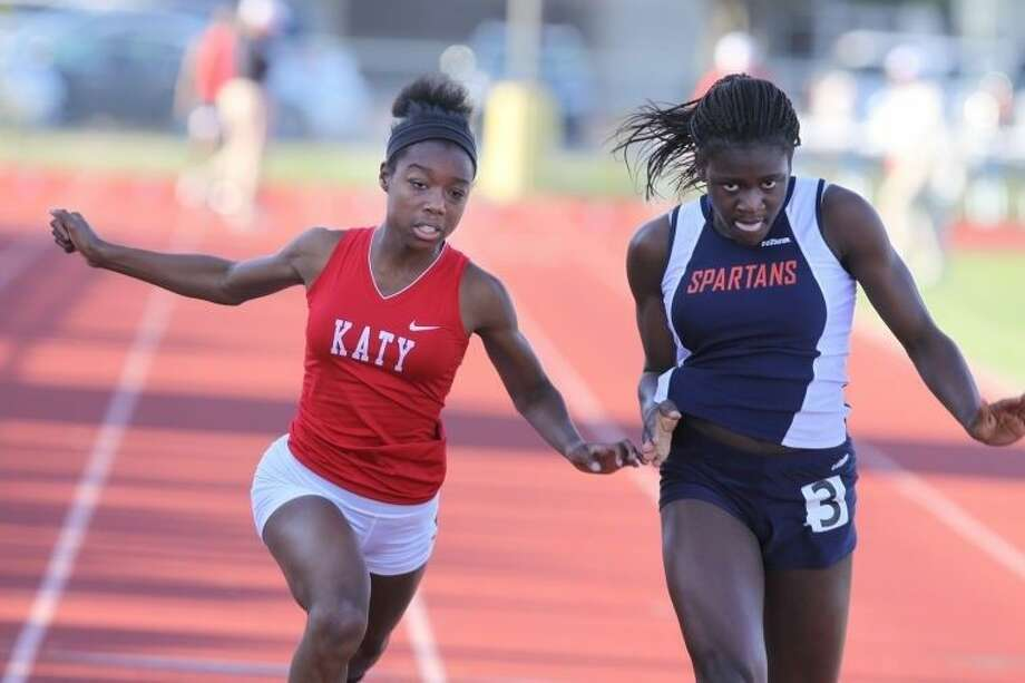 Michelle Fokam and the Seven Lakes girls won the District 19-6A/District 20-6A area championship April 23 at Stratford High School. The Lady Spartans will have seven individuals and all three relays at the Region III-6A meet May 1-2 in Humble. Photo: Alan Warren