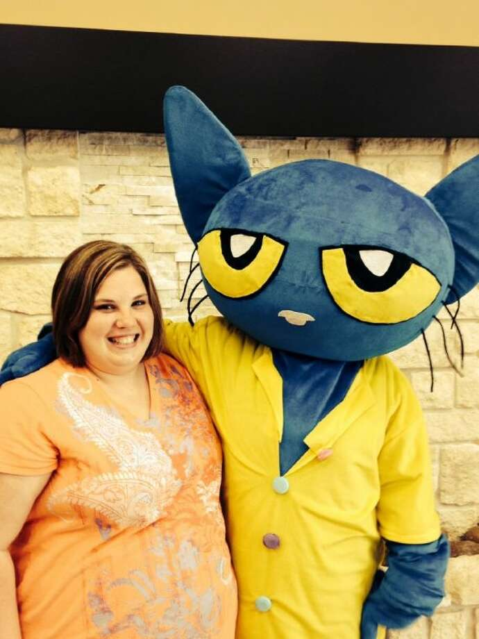 Megan Dolley had the chance to meet Pete the Cat after participating in Eric Litwin's Interactive Literacy and Music workshop held at Liberty Church on Saturday, May 10. Photo: RACHEL HALL
