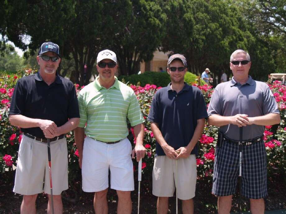 """Enjoying the sun at the 2014 tournament are, from the left, Dale Davison, Matthew Walz, and James Walz, along with Hands and Hearts Foundation President Stan Wilkening. The motto of Hands and Hearts is """"Serving Fort Bend and Beyond."""""""