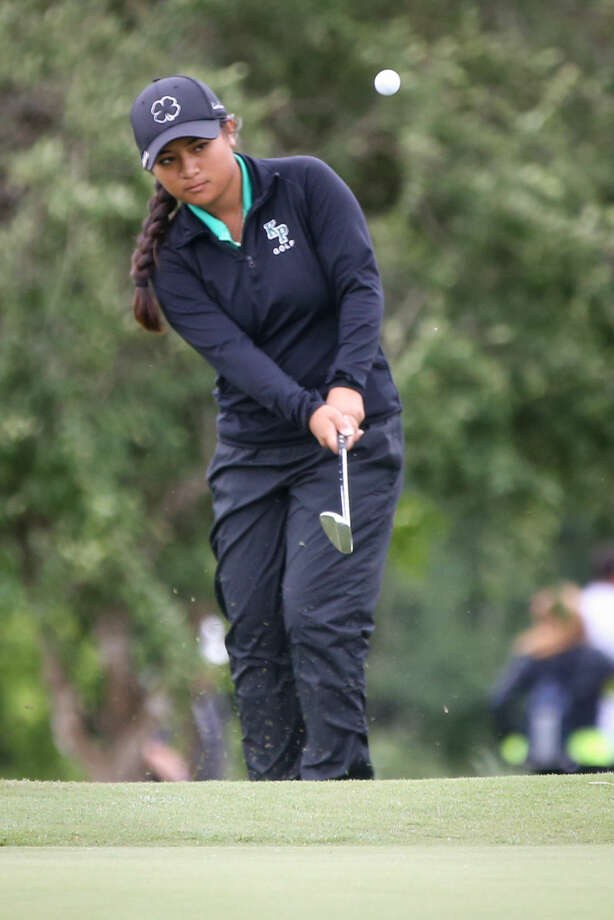 Kingwood Park's Hanna Alberto hits the ball during the UIL State Golf Championships on Tuesday, April 28, 2015, at Wolfdancer Golf Club in Cedar Creek. To view more photos from the tournament, go to HCNPics.com. (Michael Minasi / The Conroe Courier)
