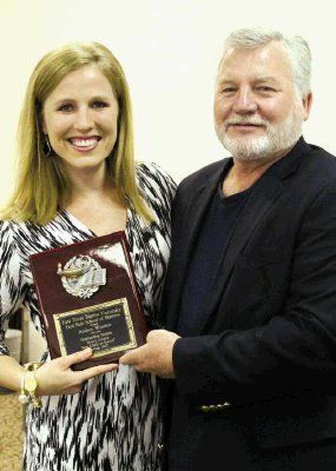 East Texas Baptist University student Audrey Winders of Kingwood receives her plaque from the Dean of the Fred M. Hale School of Business with Dr. Scott Ray naming her as the recipient of the Dean's Award. The Hale School of Business recognized outstanding students for the 2014-2015 academic year during their annual awards ceremony held Wednesday, April 22. Winders also received the award for having the highest grade point average of 3.98 and received her Bachelor of Science in Business Administration degree during Spring Commencement on May 2.