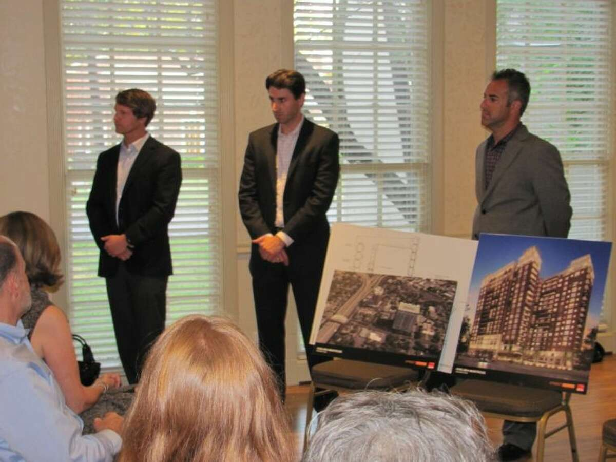 From left, Michael Goodwin and Greg Nadeau with StreetLight Residential and architect Craig Henry meet with members of the Museum Area Municipal Association about plans to develop a 20-story luxury apartment building at 4 Chelsea.