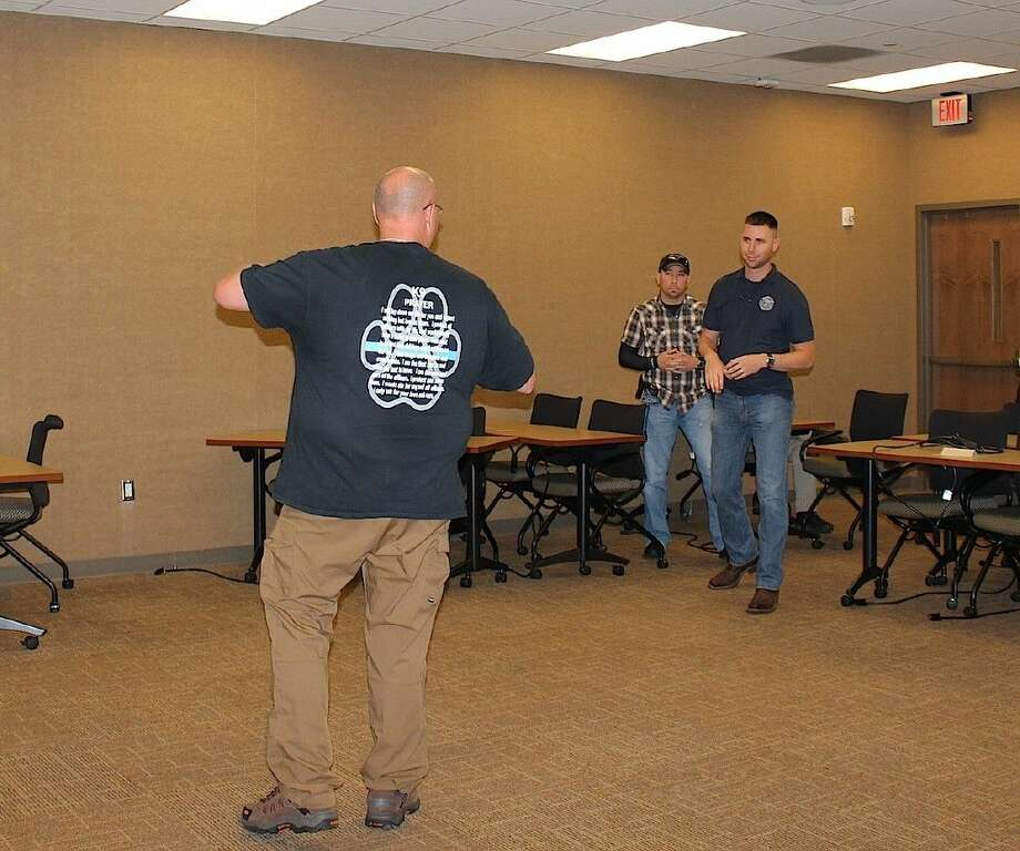 Primary and secondary officers approach a possibly mentally ill subject in a CIT role-play.