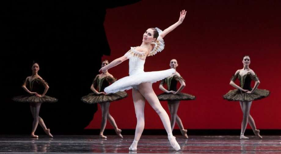 "Katharine Precourt and artists of Houston Ballet are pictured in the ""Paquita"" ballet choreographed by Stanton Welch after Marius Petipa. ""Paquita"" will be a part of three free Houston Ballet performances at the Miller Outdoor Theatre May 9-11."