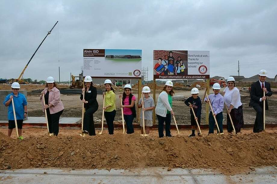 Pictured in front of the Manvel Junior High construction site are future Manvel Junior High students, along with Alvin ISD Board of Trustees, from left to right, Cheryl Harris, Regan Metoyer, Nicole Tonini, Tiffany Wennerstrom, and superintendent of schools Dr. Fred Brent. The individuals pictured are officially breaking the ground of Manvel Junior High by digging shovels into the dirt and turning it over.