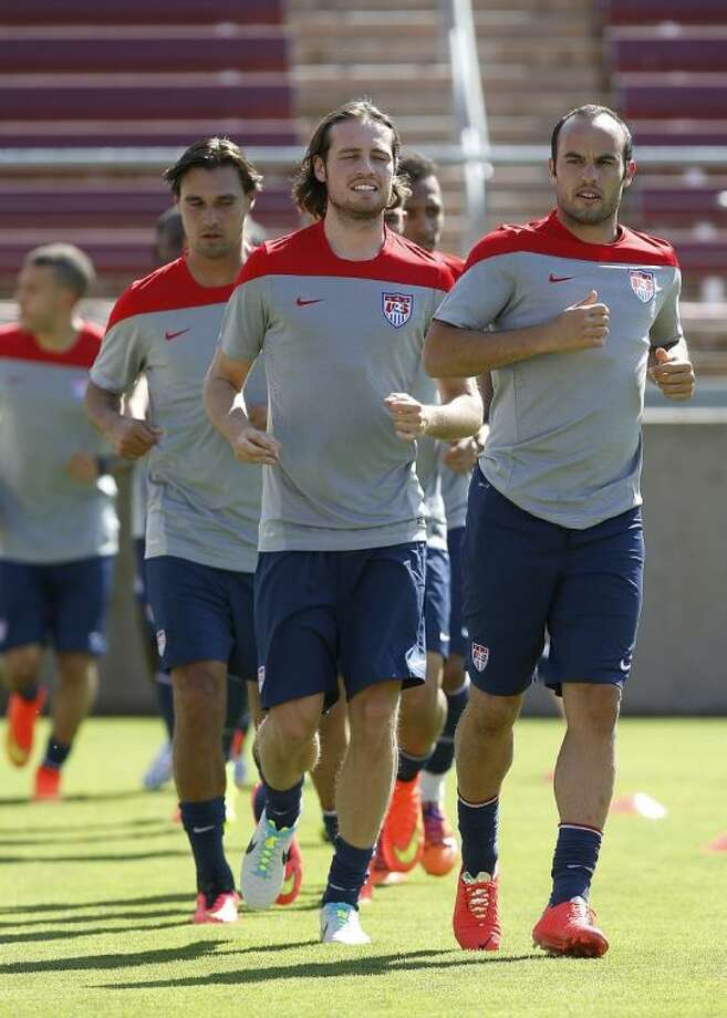 From right, Landon Donovan, Mix Diskerud and Chris Wondolowski warm up during a U.S. men's soccer team training session Wednesday in Stanford, Calif.
