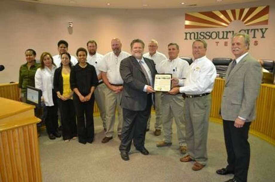 Missouri City Mayor Allen Owen presents the Permits and Inspections team with a proclamation declaring May 2014 as Building Safety Month. Photo: Photo Courtesy Missouri City