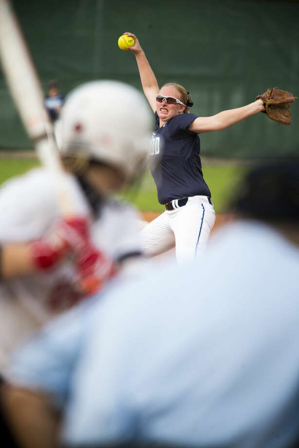 Kingwood's Ashley Johnson (14) pitches during Atascocita's 1-0 victory over Kingwood on March 17, 2015, at Atascocita High School. Photo: ANDREW BUCKLEY