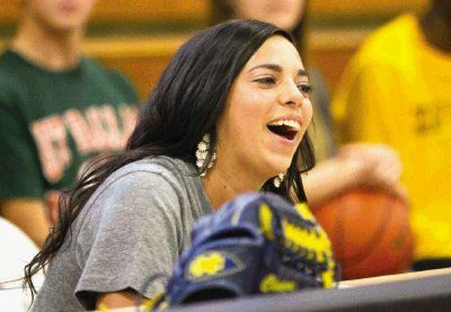 Oak Ridge's Claire Anzaldua laughs during a signing day ceremony Wednesday. Anzaldua, who signed to play softball with Mississippi College, joined 23 athletes who announced their college of choice.