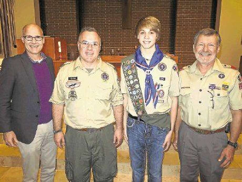 Pictured (from left to right): Pastor Randy Reeves, Scoutmaster Joe Perugini, Eagle Scout James Robinson and Dr. Jon Rawson at Robinson's Eagle Scout Award celebration.