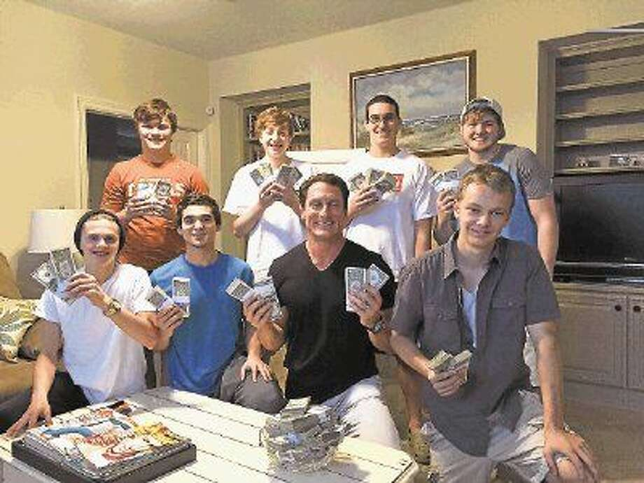 "Byron W. Ellis, managing director, Ellis & Ellis, a division of United Capital Financial Advisers, recently spoke to high school boys from The Woodlands' National Charity Roundtable organization covering the topic of money management and checkbook balancing in his presentation ""Seven Things You Can Do To Be A Millionaire."" Pictured are (back row, left to right) Cole Temple, Nick Esposito, Brian Seelig, Sean Burnett, and (front row, left to right) Will Platt, Anthony Perry, Bryon Ellis and Nolan Bradberry."